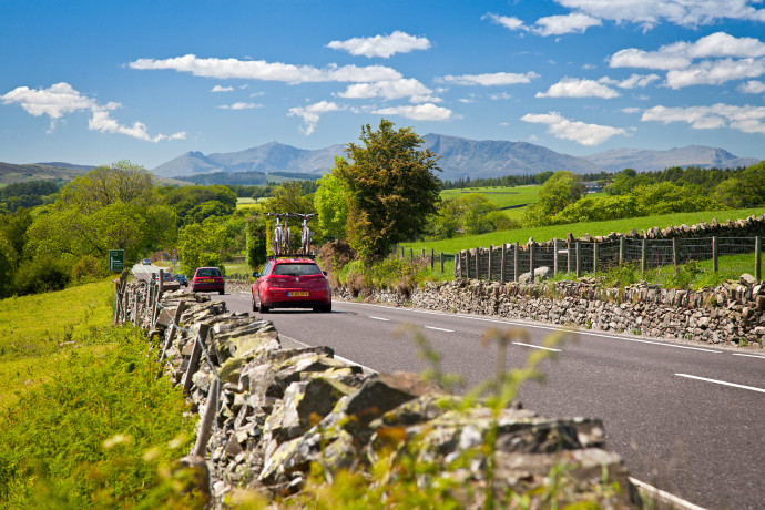 Car on A5 road near Pentrefoelas with Moel Siabod and Snowdon in background Conwy County North Road Transport